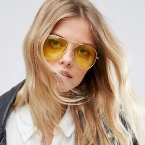 Yellow-tinted aviator sunglasses